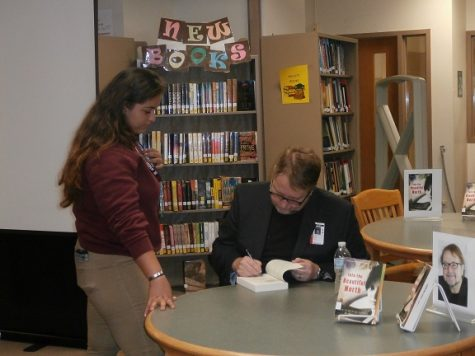 The author signed copies of students' books.