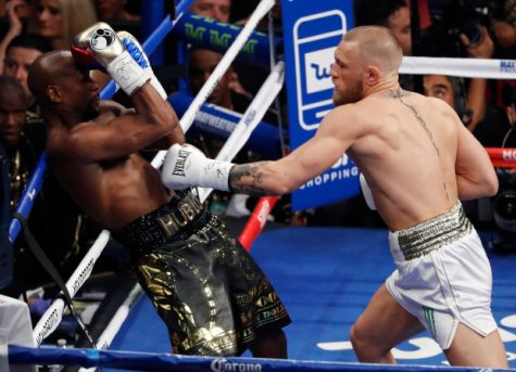 Conor McGregor pressures Floyd Mayweather with jabs during a Super Welterweight fight on Aug. 26.