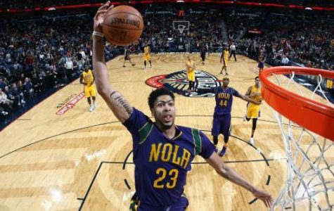 Flying High:  Anthony Davis rattles the rim with a bone-crunching dunk for the New Orleans Pelicans.