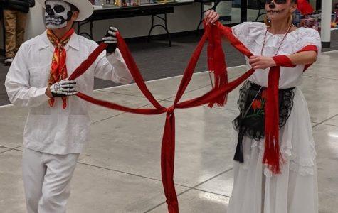Salma Morales and Mario Ramirez, a Morton alum, participate in a ceremonial dance.