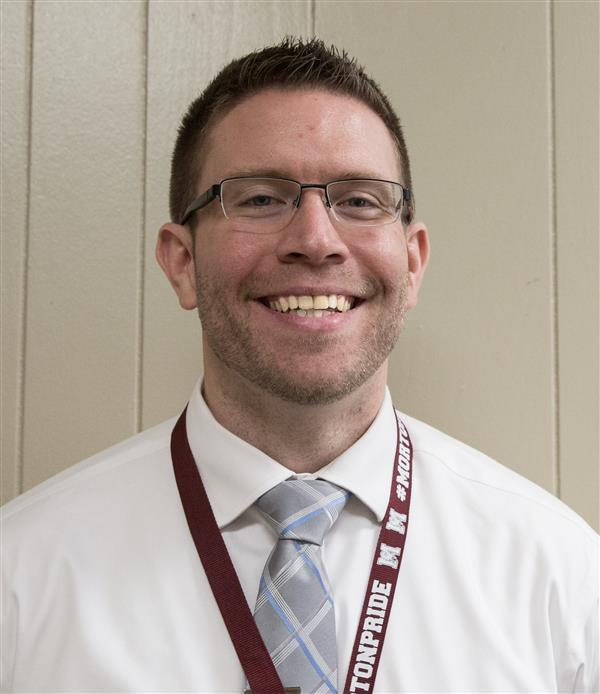 Mr.+Dugan+is+bringing+his+experience+from+Morton+East+to+his+new+role+as+Freshman+Academy+Principal+and+Assistant+Principal+of+Clubs+and+Activities.
